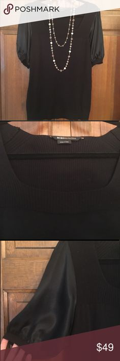 EUC BCBG Black Short Sleeve Knit Blouse EUC BCBG Black Short Sleeve Silk Knit Blouse. Square neckline and silk balloon sleeves. A GREAT option for work or play. Perfect condition as there are no stains, snags or pilling. Dry Clean Only. BCBG Tops Blouses