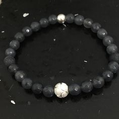 A personal favourite from my Etsy shop https://www.etsy.com/uk/listing/237028306/grey-faceted-6mm-quartz-certified
