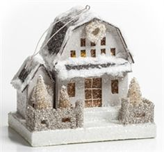 """Christmas Cardboard Barn This pretty Christmas barn is cotton snow covered and dusted in glitter. The roof is black and the barn itself is actually a light grey. It has 3 miniature bottle brush trees that are ivory and dusted with snow and glitter. The sparkly fence is a pewter color. Box base. There is a small wire hook in the top for hanging or this can be displayed in a Christmas village.  5/5"""" H x 6.25"""" L x 4.25"""" W.  Includes LED light.  By Ragon House"""