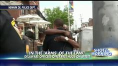 """""""Watch What Happens When Two Cops Offer People 'Free Hugs'"""" . What a simple (& Free! no PR needed) way to get the media, followed by society, on your side!"""