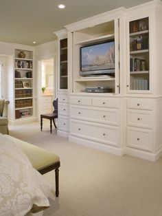 built ins facing bed w/ cabinet for hiding tv. I LOVE the built in storage space!! Looks so nice!