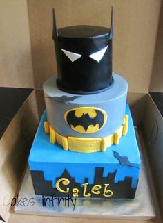 Batman inspired birthday cake!  All vanilla cake with a smoothed vanilla buttercream and fondant accents.  TFL!
