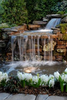 What are special considerations for a waterfall spilling over a retaining wall?
