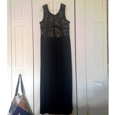 Long Black Lace Evening Gown Long black evening gown. Beautiful lace banded top with sequins that glimmer at just the right moment. Scoop back. Bottom is a light stretchy fabric that flows away from the body beautifully. Absolutely beautiful dress. Worn once to a summer night wedding in town. Price FIRM Dress Barn Dresses