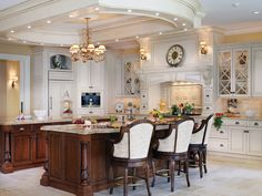 - Kitchen on HGTV.  Ceiling details with lights and chandelier over island, range hood with shelf for large clock.