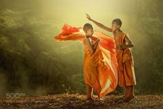 Novice buddist monk dressing. by Mingmuang