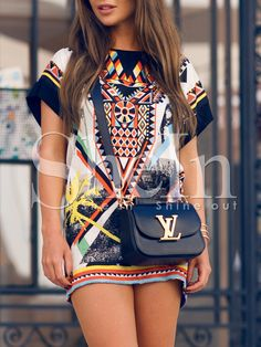 Not really my thing but I LOVE this dress. The Louis Vuitton bag makes the outfit.
