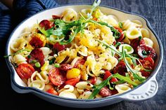 Toasting breadcrumbs in oil and spices adds crunch and flavour to this colourful pasta.