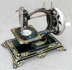 """This particular lockstitch machine is thought to have been manufactured by Clemens Muller of Dresden, Germany.  An identical example carries the marque """"Flora"""".  The shuttle mechanism is very similar to that found on the """"Todd's Champion"""". The machine was probably produced during the 1870s.     - http://www.dincum.com/library/libraryimages/lib_muller_clemens.jpg"""