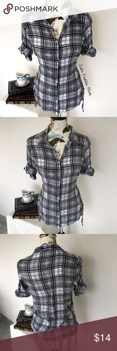 💠Just in💠 Vanity-Plaid Button Down Shirt 🌸Brand: Vanity🌸 Color(s): gray, black, and white plaid Size: Large Stretch: no Fabric Content: 100% Rayon Condition: EUC! Note: no flaws! Very soft material. Cuffed sleeves that can be worn uncuffed as well.   Measurements: (From back) Pit to pit: ~20.5 inches Shoulders: ~15 inches Length: ~27.5 inches Sleeves: ~10.5 inches cuffed ~16.5 inches uncuffed  📦Bundle your likes, and I will send you a no obligation offer. Or, submit a reasonable…
