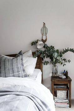 White bedroom with antique wood and leaves