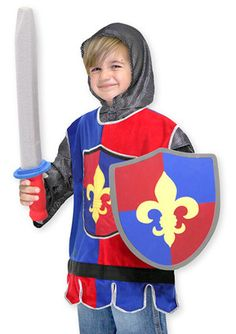 "Kids' Knight Costume Set: A fabric tunic, a ""chain mail"" hood, and durable foam sword and shield will transform your young adventurer into a valiant knight! With authentic medieval details, these role-play accessories encourage lots of exciting pretend play."