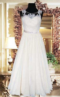 Awesome Cream Chiffon Bridal gown with French lace and Crystal beadwork for rent