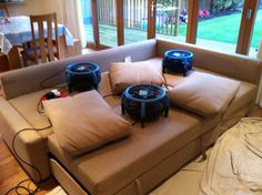 Large fans are used to dry the sofa after cleaning