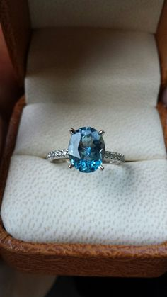 It's official! 1-17-14  Aquamarine engagement ring with diamond band.