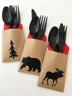 Bear, Moose & Tree Cutlery Bags - Set of 24 Add a special touch to your event with these adorable cutlery bags. This listing includes 24 kraft bags affixed with black bear, moose & tree decals; along with 24 napkins, 24 forks, 24 spoons, and 24 knives in the color of your choice. Each