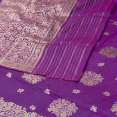 """The """"Purple"""" body of this Banarasi Silk Sari from Parisera is woven with zari floral motifs all over the body. Floral motifs in zari adorn the pallu and border. The border is repeated on the purple blouse that completes the sari."""