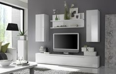 Contemporary entertainment center with hanging units. This is a hanging entertainment center with 2 storage units and one bookshelf. With two small doors and a shelf in between, this media center expresses determination, color and light, and also performs a minimal fresh opening space. This module s...