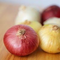 rusty metal - insert the rusty item into a half of a cut onion, twirl it around a bit, and then let sit inside the onion for about an hour.  Enzymes in the onion remove the rust and will make the metal glisten.