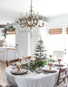 Fun Christmas table - love the mini tree centerpiece and individual cakes at each place setting