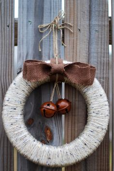 This 12 inch wreath is hand-wrapped yarn on a sturdy, light-weight frame, complete with burlap bow and bronze-colored jingle bells. Add a rustic touch to your fireplace or entry door this Christmas!