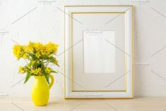 Frame mockup with yellow flowers Graphics Frame mockup with small yellow flowers in stylized pitcher vasePoster white frame mockup. Empty wh by TSTStockMockupPhotos