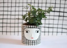 One of a kind cache-pot with sculpted face. Glazes are led free and food safe. Measures    Heigh: 9 cm  Rim: 9 cm    It comes safe and well packaged
