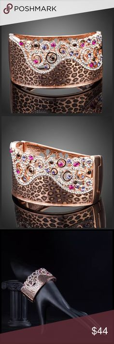"DF100 Swarovski Crystal Animal Print Cuff Bracelet ‼️ PRICE FIRM UNLESS BUNDLED WITH OTHER ITEMS FROM MY CLOSET ‼️   Swarovski Crystal Bracelet  Retail $165  To say that this is spectacular would be an understatement. Beautifully & skillfully handcrafted from the finest Swarovski crystals with a 14K rose gold overlay. Bracelet is hinged & fits up to a 7"" wrist. Please check my closet for many more items including designer clothing, scarves and much more. Jewelry Bracelets"
