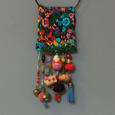 Ecofriendln Mexican Jewelry,  OOAK and unique long statement fabric pendant necklace, you will not see anywhere else!  The unique Mexican vintage fabric and the composition of all dangling element creates a fabulous boho style statement pendant.    Measurment: all pendant : 56cm - 22.04   Fabric pendant: 18cm - 7.08   ★This item is READY TO SHIP  and will be on its way to you within 3-5 days    ★ Ready to be gifted  It will be sent to you in a beautiful gift box.    This necklace would look…