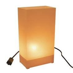 10 Count Electric Luminary Kit in Tan/Kraft by Luminarias. $35.65. 32110   Features: -Electric luminary kit. -Tan/Kraft finish. -Plastic and metal construction. -Traditional style. -Durable fold up lanterns. -Green electric cord with 36'' spacing between bulbs. -Wire anchor spikes for holding luminaries in place. -Fold up luminaries are easy to assemble and compact for storage. -Glowing look that runs on electricity. -For indoor and outdoor use. -For adults only. -Includes 1...