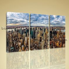 """Modern Abstract Wall Art New York City Landscape Picture Canvas Contemporary Extra Large Wall Art, Gallery Wrapped, by Bo Yi Gallery 44""""x28"""". Modern Abstract Wall Art New York City Landscape Picture Canvas Contemporary Subject : Sunset Style : Photography Panels : 3 Detail Size : 14""""x28""""x3 Overall Size : 44""""x28"""" = 112cm x 71cm Medium : Giclee Print On Canvas Condition : Brand New Frames : Gallery wrapped [FEATURES] Lightweight and easy to hang. High revolution giclee artwork/photograph...."""