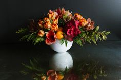 Make a statement at your holiday brunch: 'Citrus Garden' by Winston Flowers.