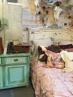 Junk Gypsy bedroom. Nightstand, Lazy Bones bedding, cow skull with roses