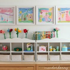Such a cute kid space. Love the framed artwork, baskets, white wall. Nice.