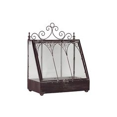 Giverny Lantern Distressed metal lantern with scrollwork and finial accents.  Product: LanternConstruction Material: Metal and g...