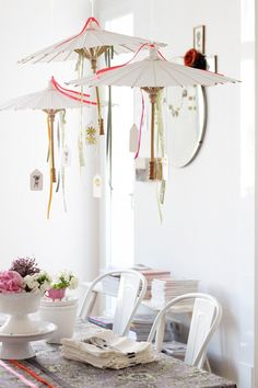 Hanging umbrellas over table -japanese themed party