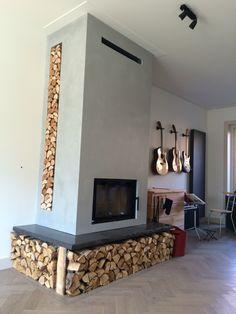 Inbouw cv haard met betonblad en cement stucwerk