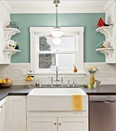Bright kitchen with sea foam walls