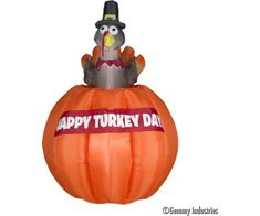 Animated Turkey Rising out of Pumpkin. Thanksgiving is not too far away...Fun Thanksgiving Inflatable that will grab everyone's attention.  Is this Turkey the stuffing this year?  Bright colorful large pumpkin has a banner attached wishing everyone Happy Turkey Day.