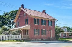 """Historical 1817 """"Andrew Brunner"""" residence in historic East Berlin, PA. Federal-style brick home with 2,700+ sq. ft. Authenticity abounds. Original wood floors, chair rails and walk-in functioning hearth fireplace. Original 1814 stone carriage barn w/1,885 sq. ft. is now utilized as a small local business."""