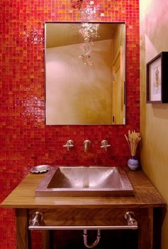 Create a perfect blend of three colors that complement each other. For example, you can use red tile on one kitchen wall, paint the floor and some cabinets a soft shade of yellow, and incorporate some orange colored furniture.