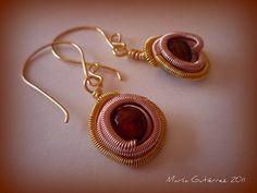 Zarcillos espiral dorados y oro rosa