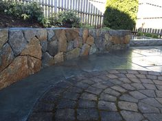 Stone Wall and Blue Stone Walkway.
