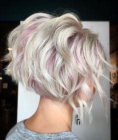 Ice blonde short wavy bob pink highlights