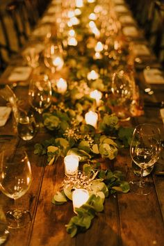 Rustic country wedding reception table with natural greenery and votive candles | Sophie Baker Photography