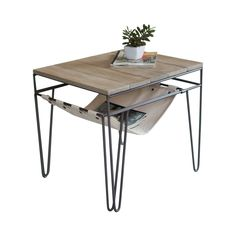 A fresh contemporary feel emanates from the Fairbanks Table, a design-forward concept marrying a sleek wood-plank top with a geometric metal frame, and throwing in a bonus canvas sling shelf under the ...  Find the Fairbanks Table, as seen in the Vintage Athletic Club Collection at http://dotandbo.com/collections/vintage-athletic-club?utm_source=pinterest&utm_medium=organic&db_sku=112692