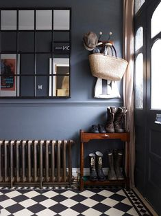 Dark hallway interiors with inky blue walls, a cast iron radiator and window pane wall mirror. Compact shoe storage for hallway. Also, I'd forgotten how much I LOVE chequered floors. Dark Hallway, Tiled Hallway, Hallway Mirror, Foyer, Entry Tile, Hallway Paint, Mirror House, Window Mirror, Diy Mirror