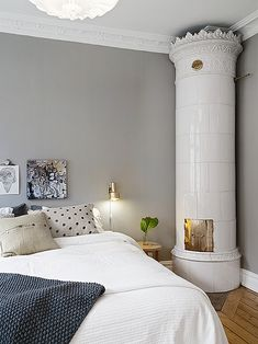 grey wall in Scandinavian bedroom