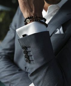 Black onyx with grey suit.  Bracelet to look less formal - http://www.cufflinks.com/menscuffwear.html