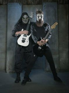 Mick Thomson and Jim Root Bunny ears! er... horns...